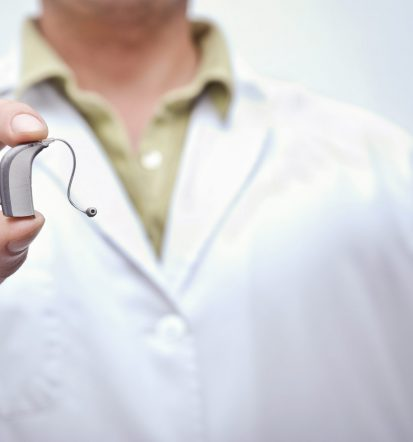 Doctor showing hearing aid